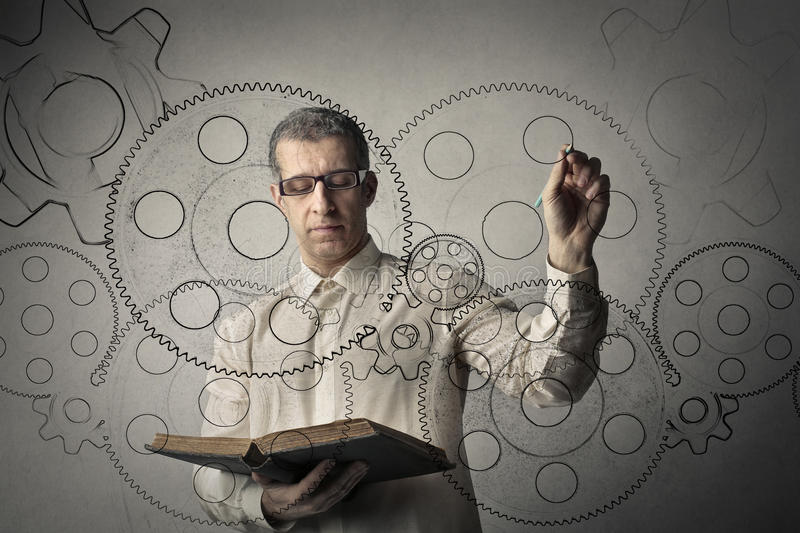 Man painting gears royalty free stock photo