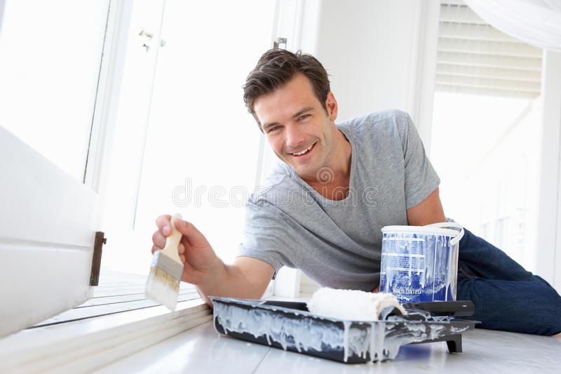 Download Man painting house stock image. Image of inside, happy - 21044883