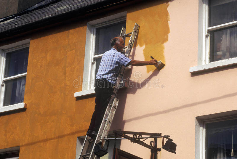 Man painting a house in Cork, Ireland stock photo