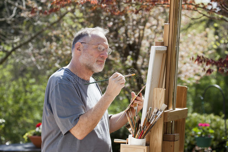 Download Man Painting Outdoors stock photo. Image of artist, canvas - 16997910
