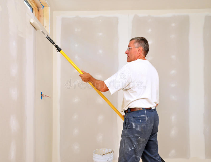 Man Painting Room With Roller Royalty Free Stock Images
