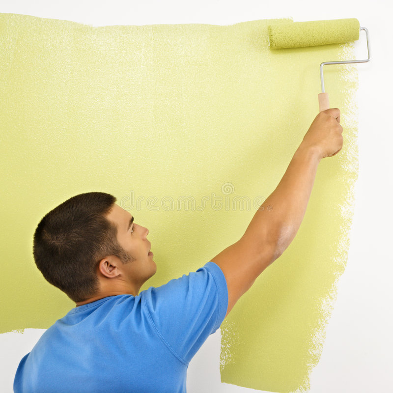 Man painting wall. royalty free stock image
