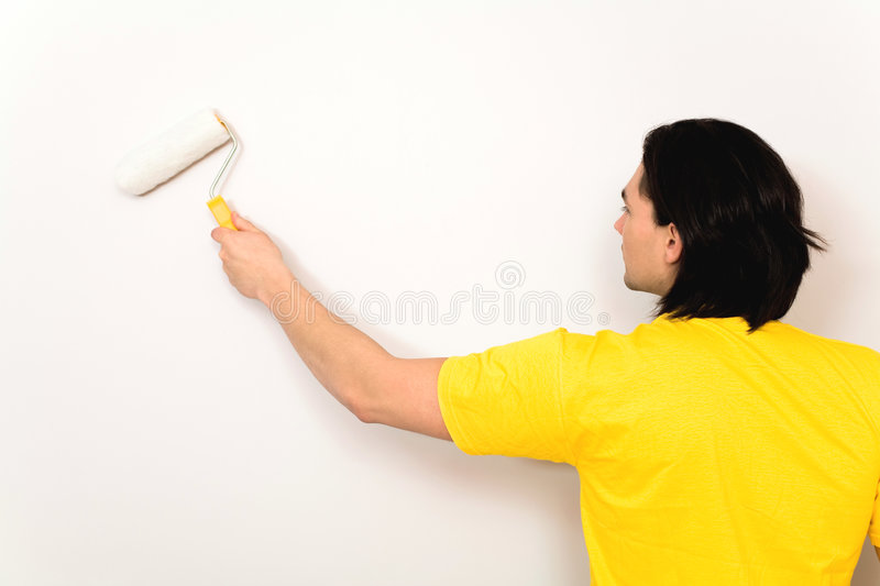 Man painting wall royalty free stock images
