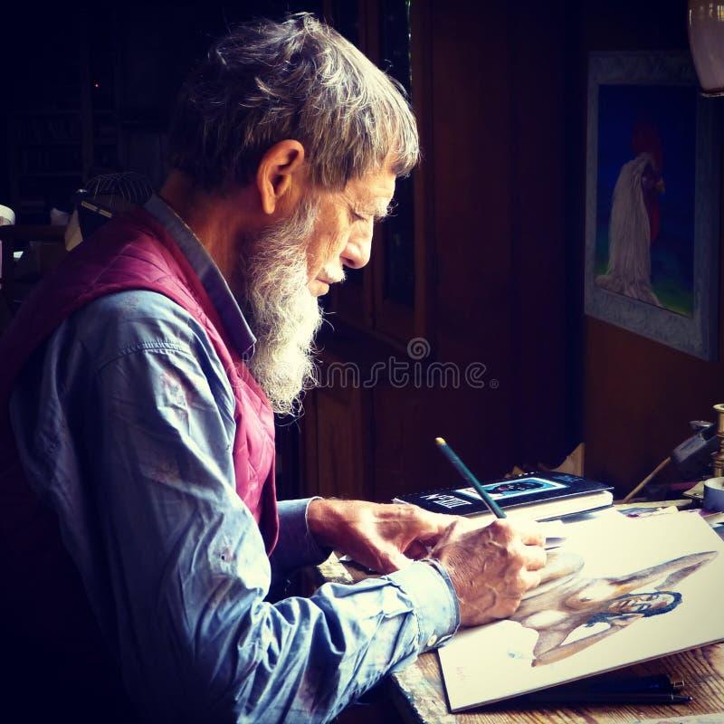 Man Painting Wearing Blue Dress Shirts stock photo