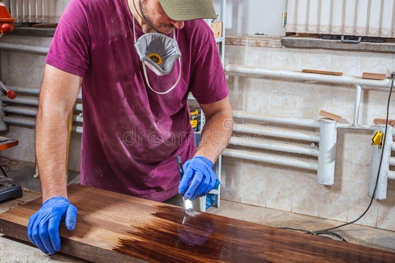 Man paints a wooden stock images