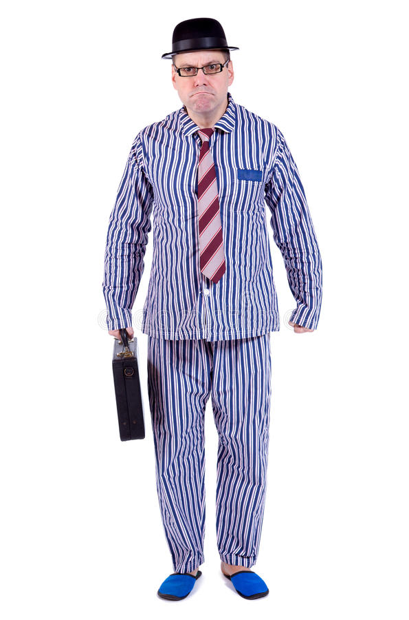 Man in pajamas with suitcase royalty free stock image