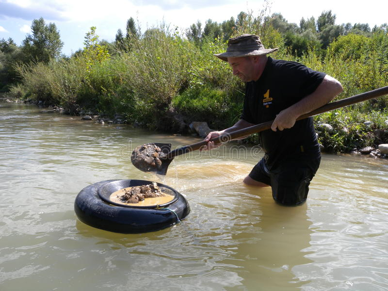 Man panning for gold. In a river,in the south of France royalty free stock image
