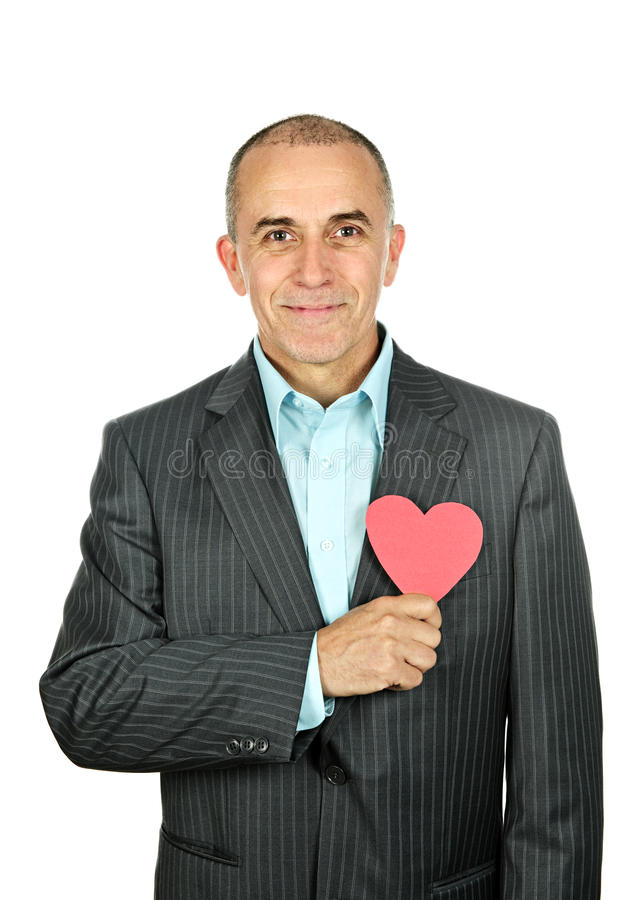 Man with paper heart on white background stock photos