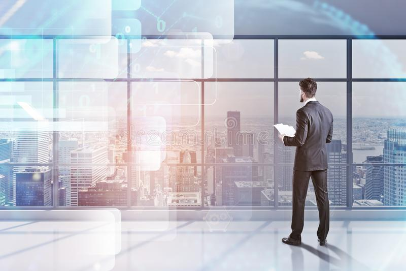 Man with papers in office, digital interface. Businessman with documents standing in panoramic office with planet hologram and immersive digital interface over stock photos