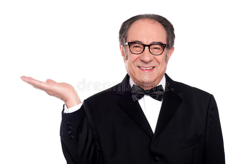 Download Man In Party Wear Presenting Copy Space Stock Photo - Image: 25622220