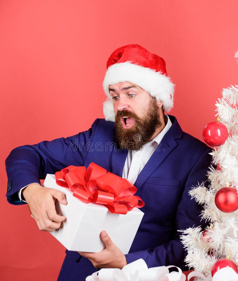 Man party at xmas tree. Gift service concept. Send or receive christmas present. Quick gift delivery. happy holidays stock photography