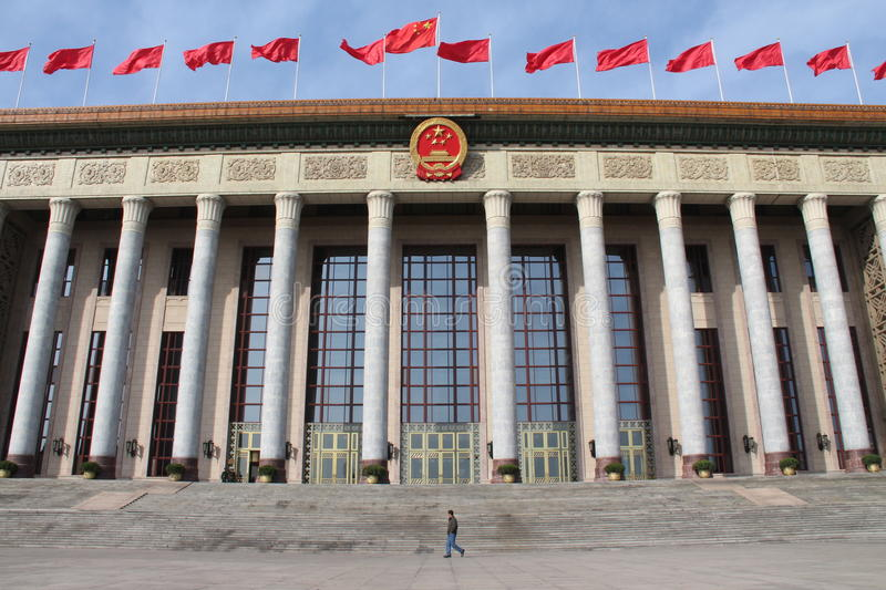 Man passing by Great Hall of People in Beijing royalty free stock photography