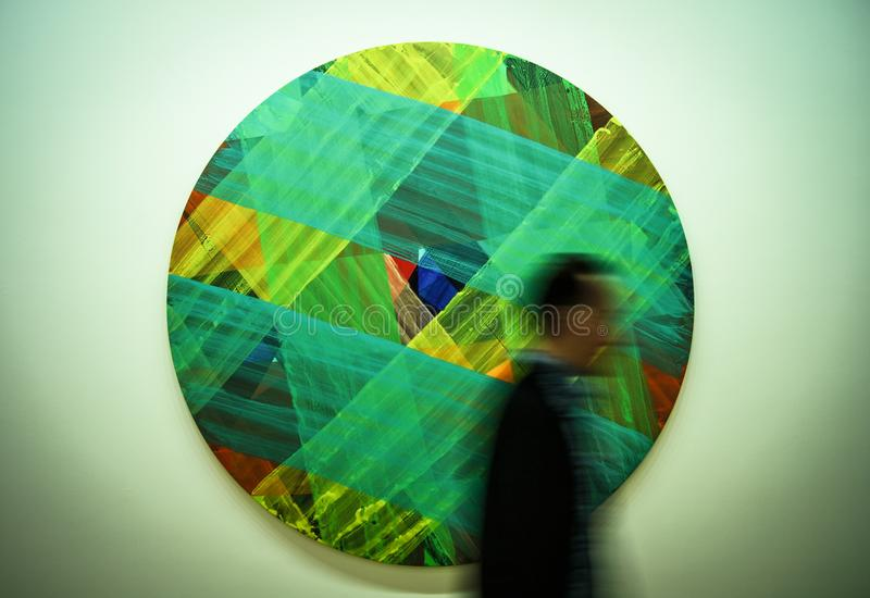 Man Passing by Multicolored Art stock images