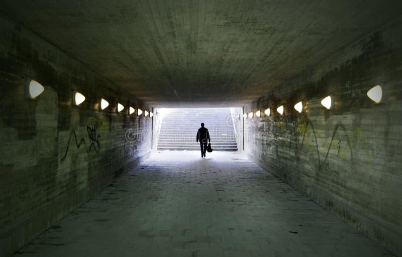 Man passing through underpass stock photos