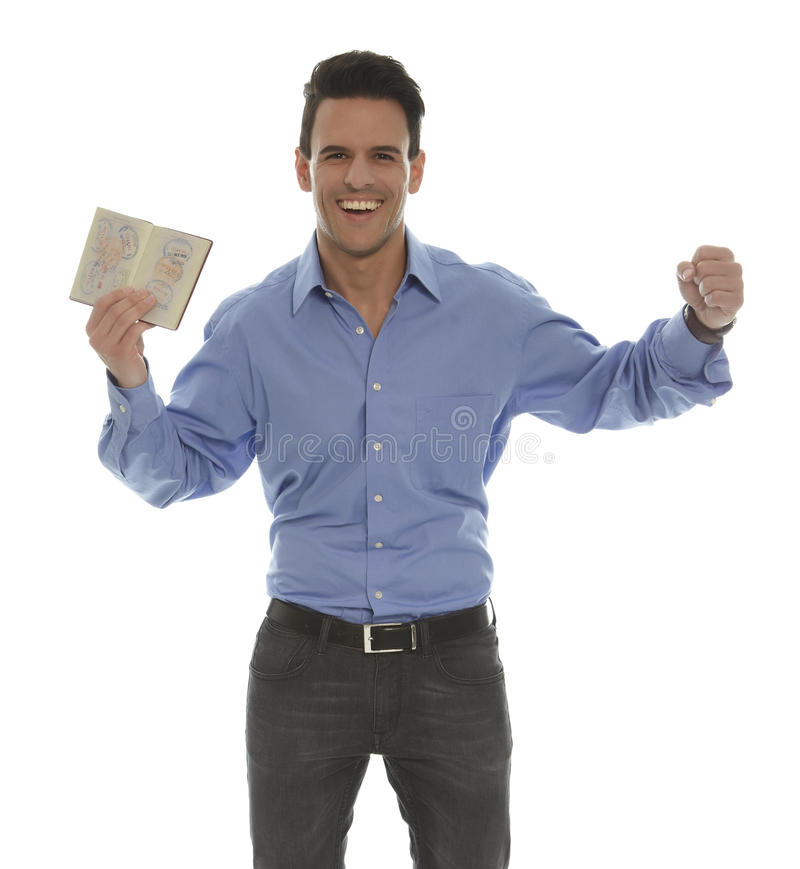 Man with passport. With a toothy smile royalty free stock photos