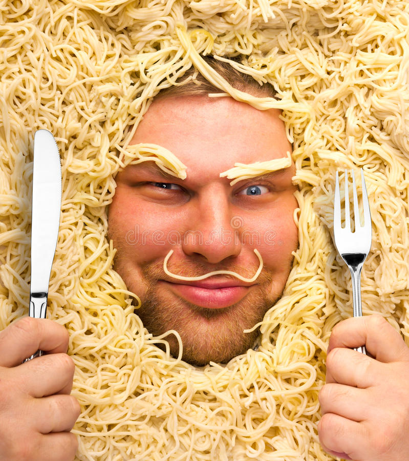 Man in pasta stock photos