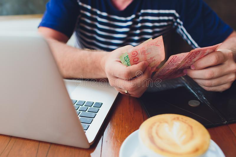Man paying bill in cafe. He putting money. Busy man having lunch in restaurant. service concept. stock images