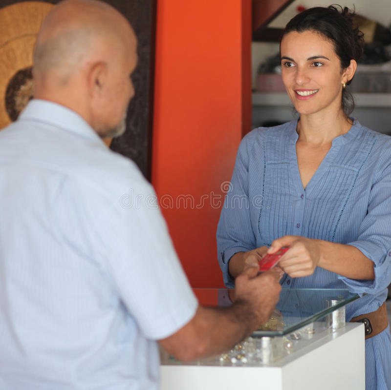 Man paying with credit card. In a shop stock photos