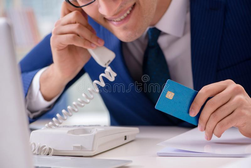 The man paying with credit card online. Man paying with credit card online stock images