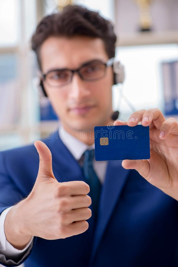 The man paying with credit card online. Man paying with credit card online royalty free stock images