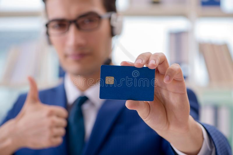 The man paying with credit card online. Man paying with credit card online royalty free stock photography