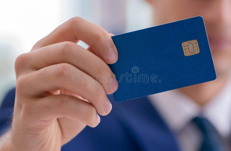 Man paying with credit card online. The man paying with credit card online royalty free stock photography