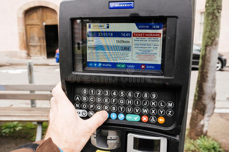 Man paying for parking in city France Strasbourg royalty free stock images