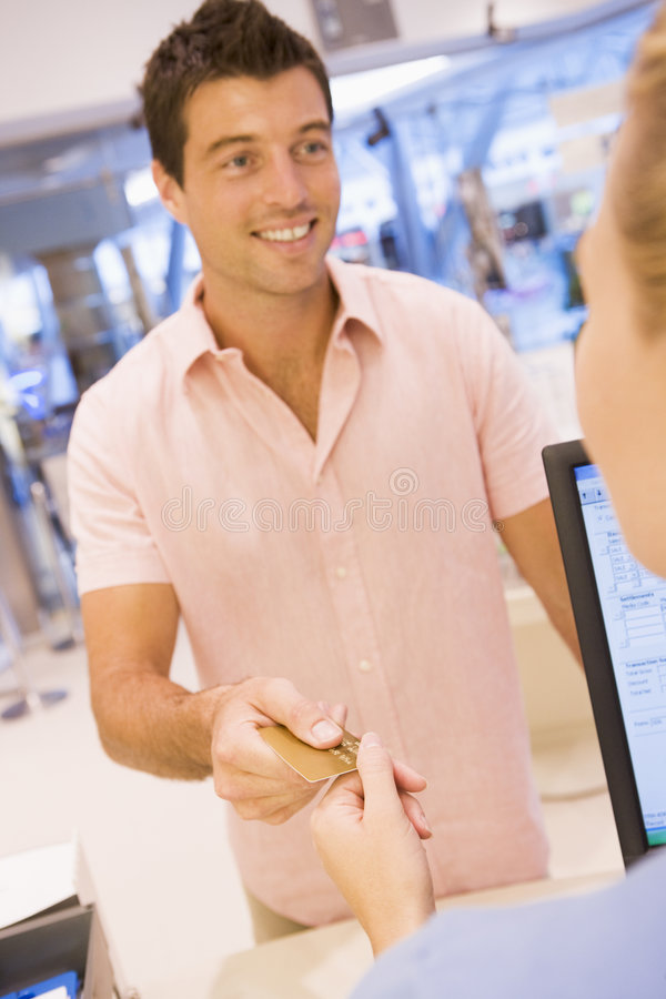 Man paying in store stock photo