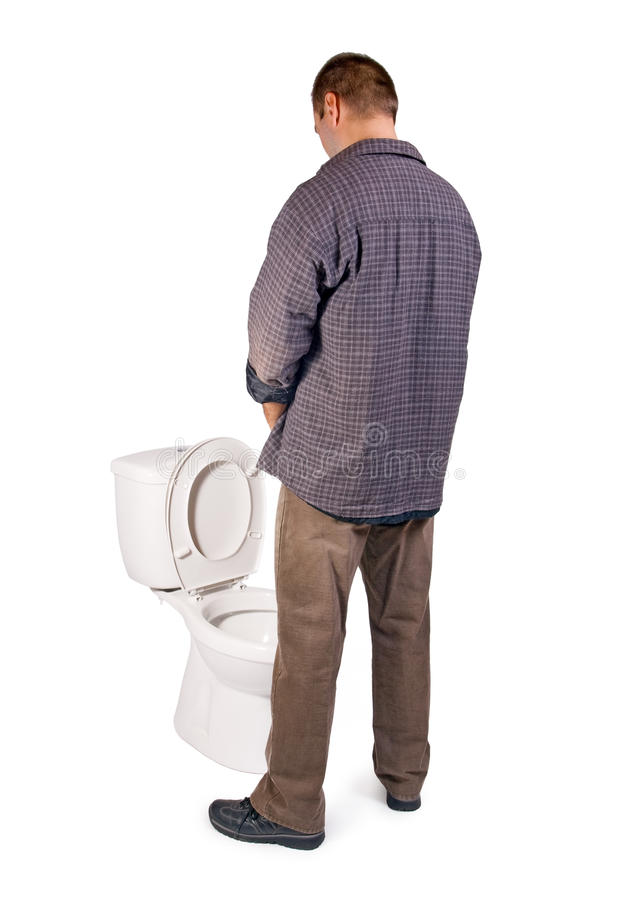 Man pee on the toilet royalty free stock images