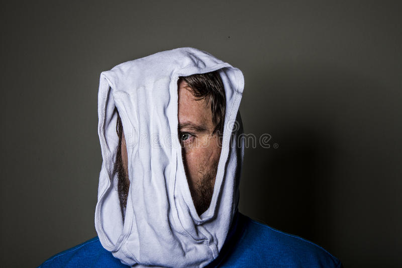 Man peeking out through the hole in the underwear on his head stock photo