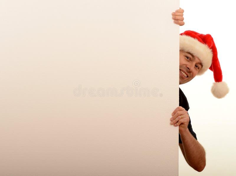 Man peeping around wall royalty free stock image
