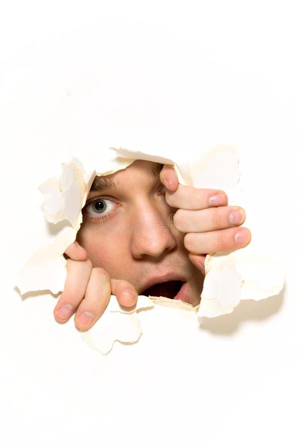 Download Man Peeping Through Hole On Paper Stock Photo - Image: 18447192