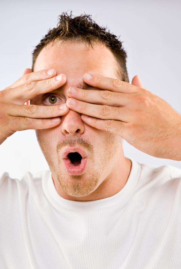Download Man Peering From Behind Hands Stock Image - Image: 17050927