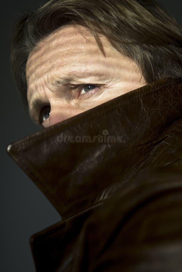 Free Man Peering Over Collar Stock Photo - 12379910