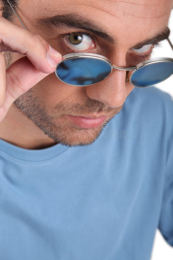 Download Man Peering Over His Sunglasses Stock Image - Image: 24731603
