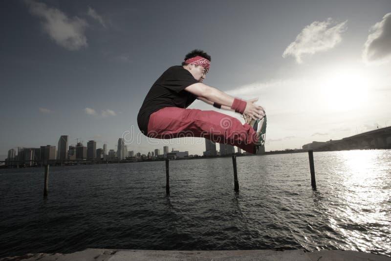 Man Performing A Midair Toe Grab Stock Photography