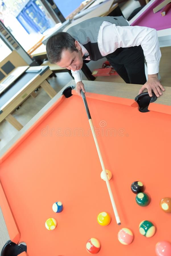 Man performing pool demonstration at pool store stock images