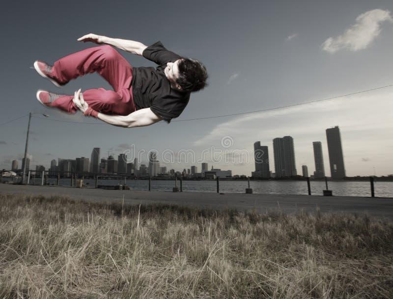 Man performing a sideways flip. Breakdancer performing a midair flip stock photos