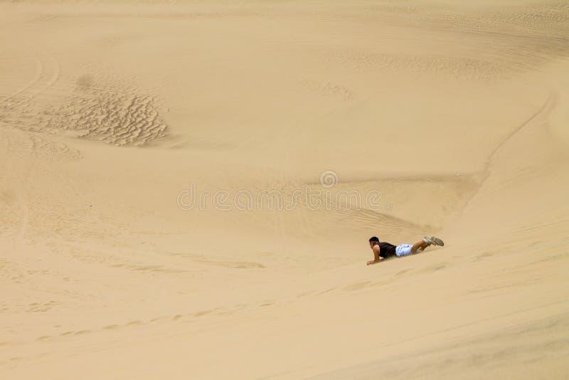 Man performing sky in Peru desert. In Ica royalty free stock image