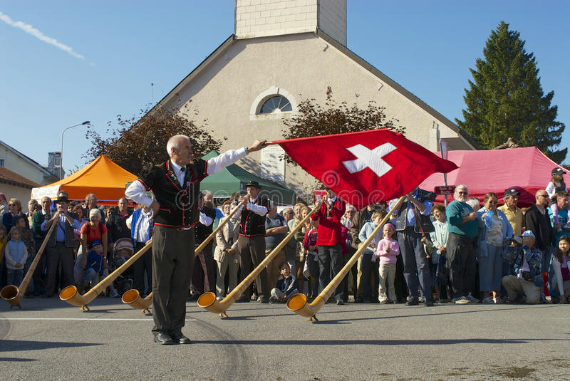 Man performs traditional flag twirling in Affoltern Im Emmental, Switzerland. stock image