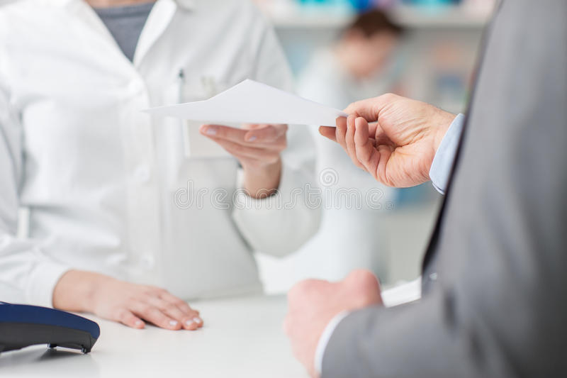 Man at the pharmacy royalty free stock images