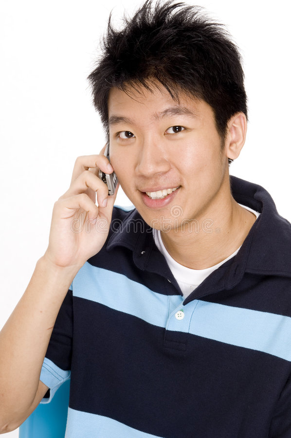 Man On Phone. A young chinese man using a phone royalty free stock image