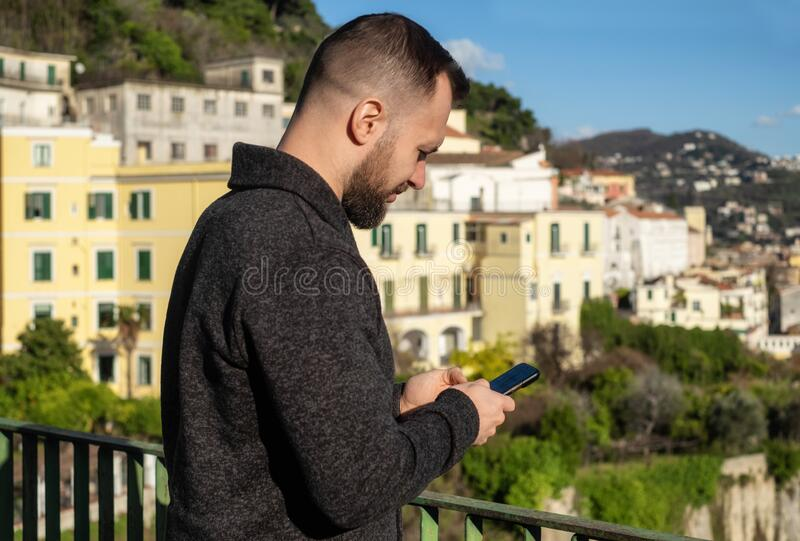 Man with a phone against Salerno city view, Italy royalty free stock photo