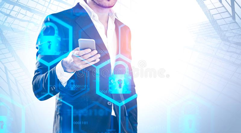 Man with phone in city, online security. Unrecognizable businessman holding smartphone over abstract city background with double exposure of online security royalty free stock photography