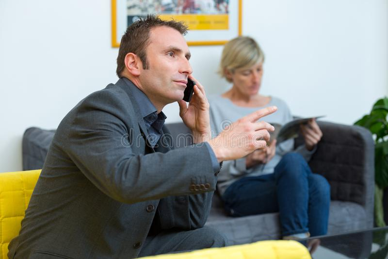 Man on phone while waiting stock photography
