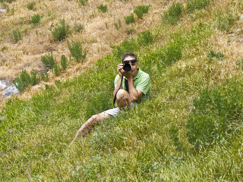 Download Man with photocamera stock photo. Image of grass, adult - 25209382