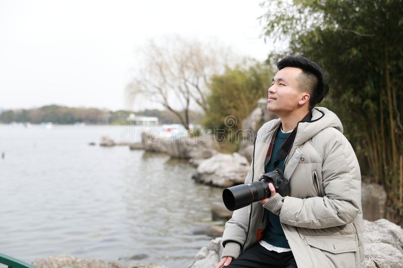 Asian chinese man photographer in park stock photography