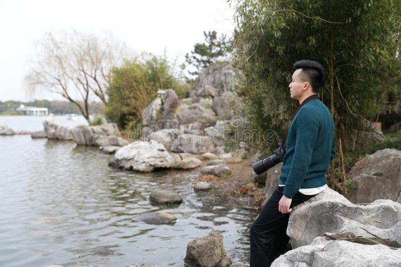 Asian chinese man photographer in park stock image