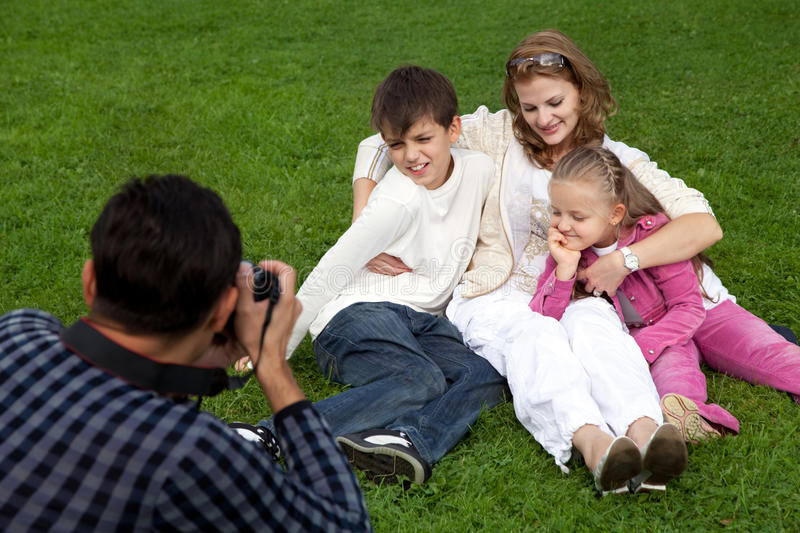 Man photographes his family outdoors royalty free stock images