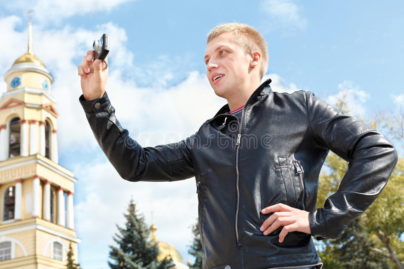 Download Man Photographing City's Attractions Stock Image - Image: 21767091